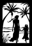 Matriz com a criança na praia Fotos de Stock