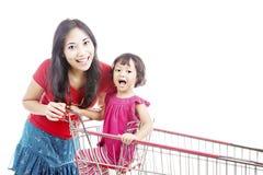 Matriz com a filha no trole Imagens de Stock Royalty Free