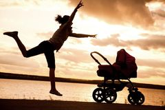 Matriz com um carrinho de criança Imagem de Stock