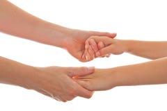 Matriz e criança que dão ambas as mãos Fotografia de Stock