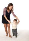 A matriz e seu filho pequeno que jogam junto Foto de Stock Royalty Free