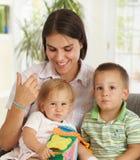 Matriz feliz com duas crianças Imagens de Stock Royalty Free