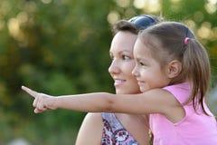 Matriz feliz com filha Imagens de Stock