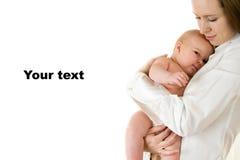 Matriz feliz que prende um bebé novo Imagem de Stock