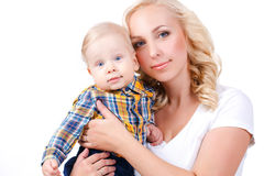 Matriz nova que joga com seu filho pequeno Fotografia de Stock Royalty Free