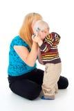 Matriz que consola a criança foto de stock