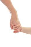 Matriz que dá uma mão a uma criança Fotografia de Stock