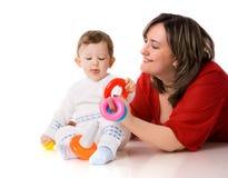 Matriz que joga com criança Imagem de Stock Royalty Free
