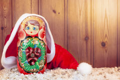 Matryoshka covered by christmas hat warm look filtered Royalty Free Stock Photo