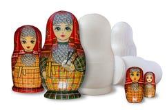 Matryoshka Dipinto e non dipinto Isolato su bianco fotografie stock libere da diritti