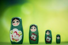 Matryoshka doll. A matryoshka doll, also known as a Russian nesting doll, Stacking dolls, or Russian doll, is a set of wooden dolls of decreasing size placed one stock photo