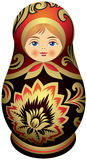 Matryoshka doll with the golden Khokhloma  ornamen Royalty Free Stock Photos