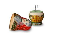 Matryoshka doll pincushion. Sewing needles. Close up stock photos