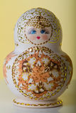 Matryoshka doll, Russian handicraft. Matryoshka doll with yellow background, Russian handicraft Royalty Free Stock Photos