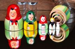 Matryoshka dolls. And a mirror stock images