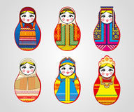 Matryoshka dolls in different outfits Stock Photography