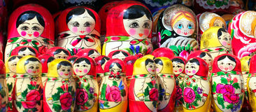 Matryoshka dolls panorama. Russian Matryoshka dolls at a souvenir stall in Moscow. Matryoshkas are a set of wooden dolls of increasing size placed one inside the Royalty Free Stock Photos
