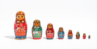 Matryoshka dolls, in a row, in order of size. Close-up of a set of Russian decorative Matryoshka dolls, in a row, in order of size, from the biggest to the Stock Photos
