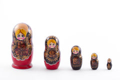 Matryoshka dolls. Traditional Russian matryoshka dolls in a row on white background Royalty Free Stock Images