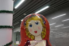Matryoshka in the interior of Adler station in the evening stock image