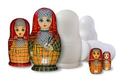 Matryoshka. Painted and unpainted. Isolated on white royalty free stock photos