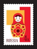 Matryoshka russian nesting doll postal stamp. Mail from Russia Royalty Free Stock Photo