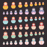 Matryoshka Russian nesting dolls different sizes from big to small on black background Stock Photo