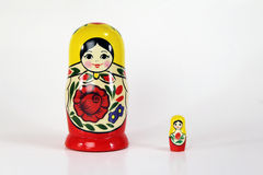Matryoshka Russian Nesting Dolls. Isolated shot of the largest and smallest Russian Matryoshka nesting dolls (Babushkas) standing next to each other with copy Stock Photos