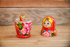 Matryoshkas, russian nesting dolls on wood background, mother, daughter and family concept Stock Photos