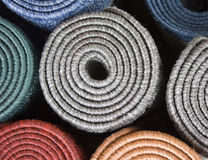 Mats. A selection of colourful rolled up mats Royalty Free Stock Photography