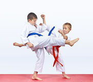 On the mats athletes are training blows legs Stock Photography