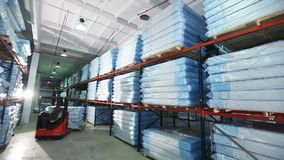 Mats production, mattress warehouse on production, skidder for mattresses, modern factory, mattresses in stock, general. Plan stock footage