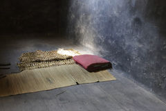 Mats and quilts in dark room. Dark room of zhazi prison ruins site, chongqing city, china Stock Image