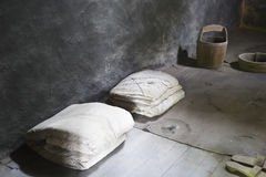 Mats and quilts in prison room. Dark room of zhazi prison ruins site, chongqing city, china Royalty Free Stock Photo