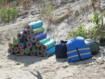 The mats are stacked in a clearing to prepare for the hike. stock photography
