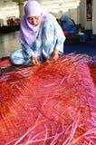 Mats weaving. Stock Photography
