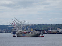 Matson shipping boat towed into Seattle harbor Stock Images