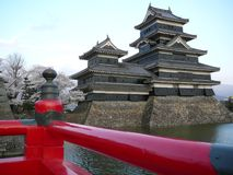 Matsumoto Castle. With red bridge stock images