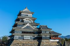 Matsumoto castle and blue sky on rock wall. At Matsumoto, Nagano Prefecture, Japan royalty free stock photography