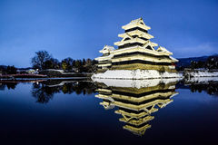 Matsumoto Castle with water reflection during winter. Clear blue sky enables a crystal clear reflection Royalty Free Stock Images