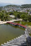 Matsumoto - Japan, June 6, 2017: Red bridge over the moat seen f Stock Photography