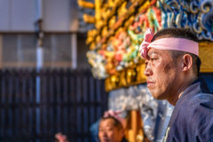 Matsuri man. A matsuri (festival) man walks into the frame with a face full of intent, concentration and determination stock photography