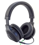 Matt black headphones with a headset with a green wire cuted isolated Stock Photos