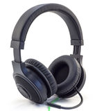 Matt black headphones with a headset with a green wire isolated Stock Photos