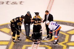 Matt Brown drops the first puck. Royalty Free Stock Photo