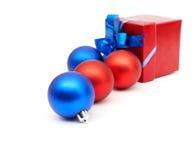 Matt christmas balls and red gift box Royalty Free Stock Photography