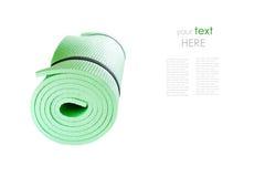 Matt rulle för yoga som isoleras på vit med prövkopiatext Fotografering för Bildbyråer