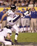 Matt Stover. Kicker Matt Stover of the Baltimore Ravens goes for the extra point after the Baltimore Ravens score a touchdown.. The Baltimore Ravens  went on to Stock Image