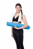 Matta nätta blått för idrottshallkvinnainnehav royaltyfri foto