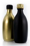 Matte black and gold bottles Stock Image